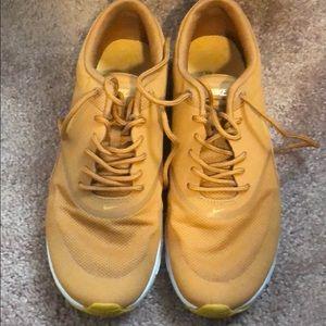 Unique mustard color Nikes
